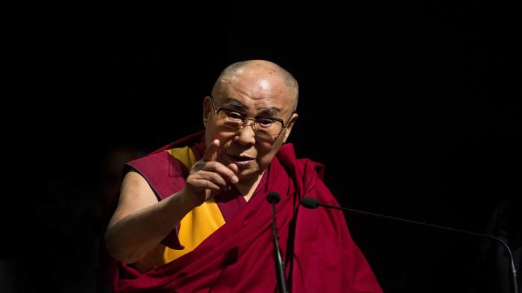 """Tibetan spiritual leader the Dalai Lama delivers a lecture on """"Ancient Indian Knowledge in Modern Times"""" at the Gauhati university campus in Gauhati, north eastern Assam state, India, Sunday, April 2, 2017. (AP Photo/Anupam Nath)"""
