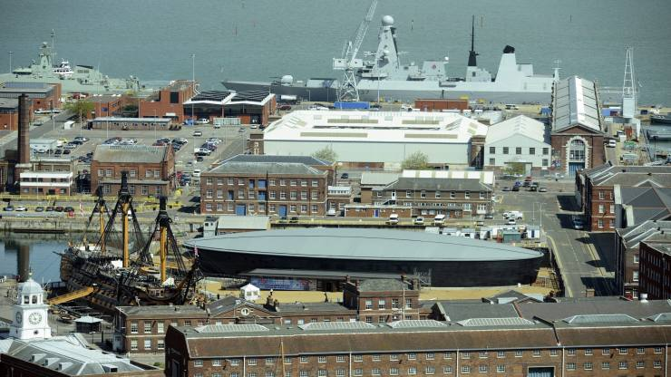"Portsmouth harbour as BAE Systems announce cutting 1,775 jobs at British shipyards...epa03939661 A general view showing a part of the harbour and docks of Portsmouth, Britain, 25 May 2013. At front left is the historic HMS Victory, flagship of Horatio Nelson. At right from HMS Victory is the Mary Rose Museum, both at Portsmouth Historic Dockyard, and at the top is Royal Navy's destroyer HMS Duncan. Defence giant BAE Systems on 06 November 2013 announced it would cut 1,775 jobs at several shipyards across Britain, following a ""significant"" drop-off in workload as it completed aircraft carrier contracts. The cuts mean that ship-building will end next year altogether in Portsmouth, one of the maritime nation's most historic yards, though repair work will still be carried out there. The southern English city will see 940 jobs cut while another 835 will be lost at a yard in Filton, near Bristol, and from Scottish yards in Glasgow and Rosyth.  EPA/MAURITZ ANTIN"