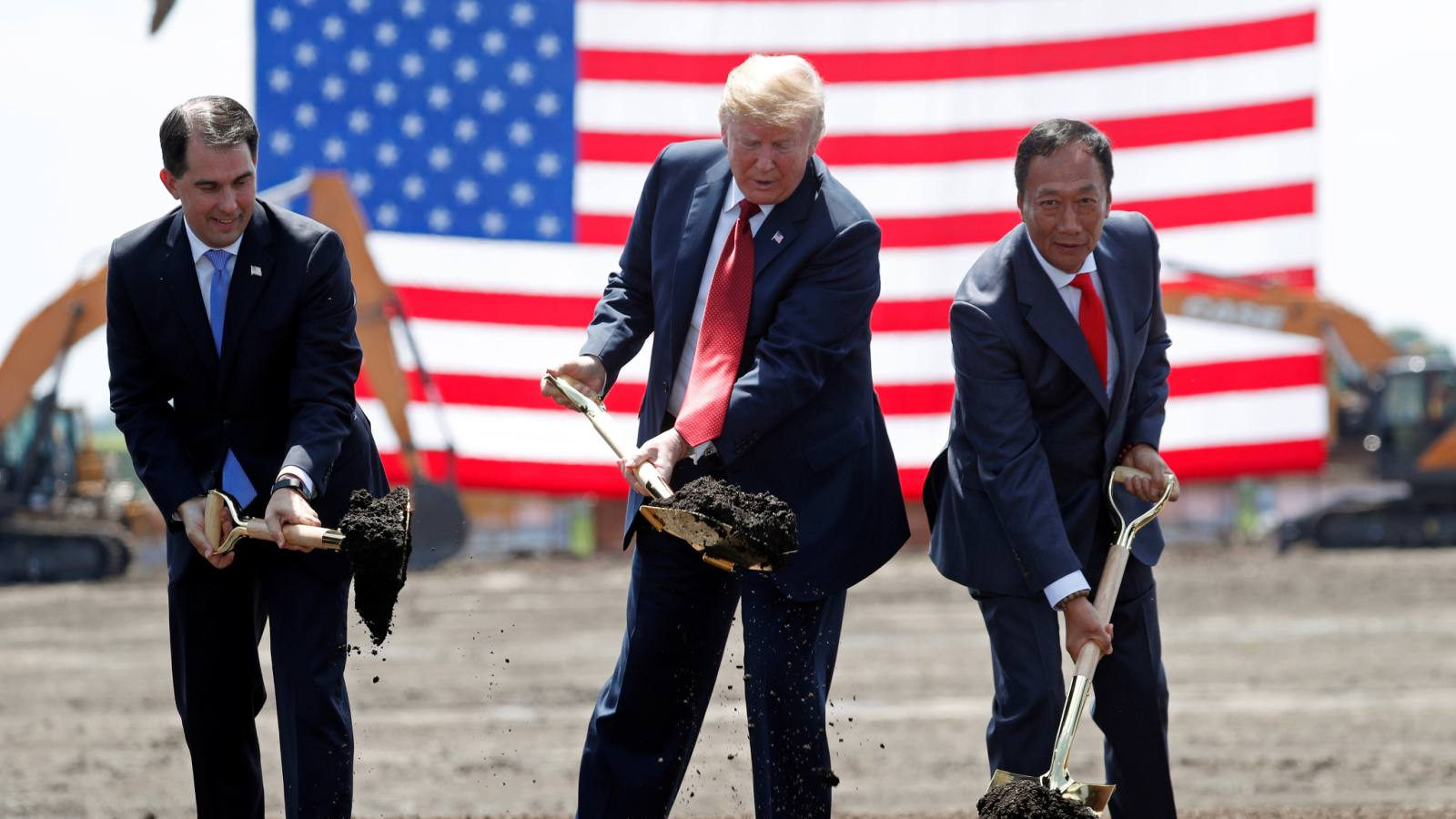 U.S. President Donald Trump takes part in a groundbreaking with Wisconsin Governor Scott Walker,left, and Foxconn Chairman Terry Gou, right, during a visit to Foxconn's new site in Mount Pleasant, Wisconsin, U.S. on June 28.