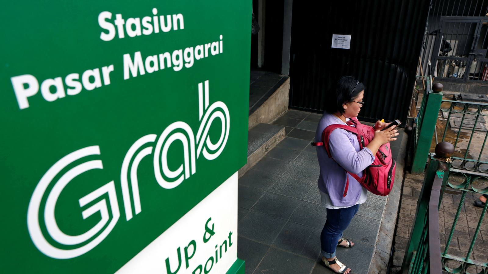 The pickup and drop-off point for the online ride-hailing service Grab at the Manggarai train station in Jakarta.