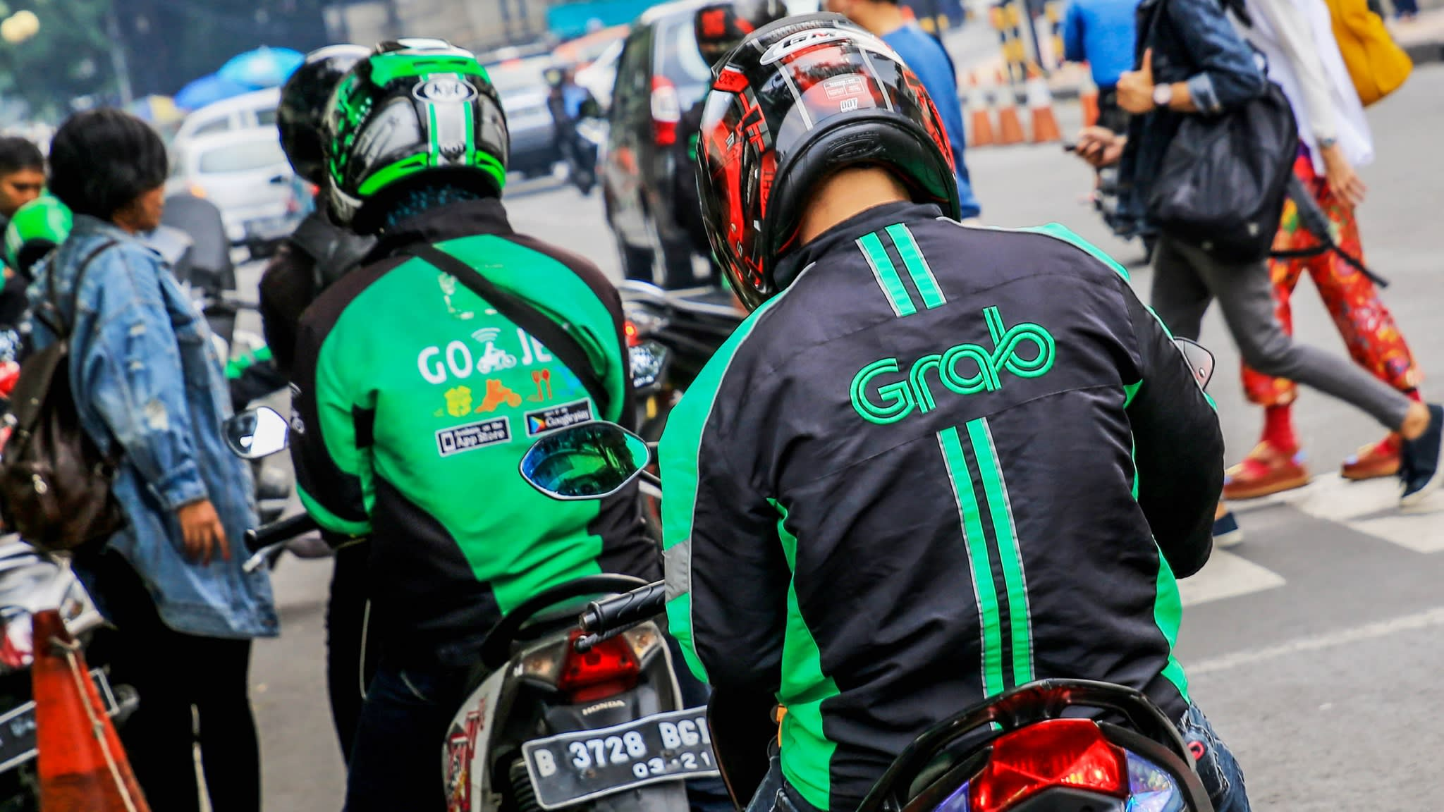 A Go-Jek and Grab driver  waiting for the customers
