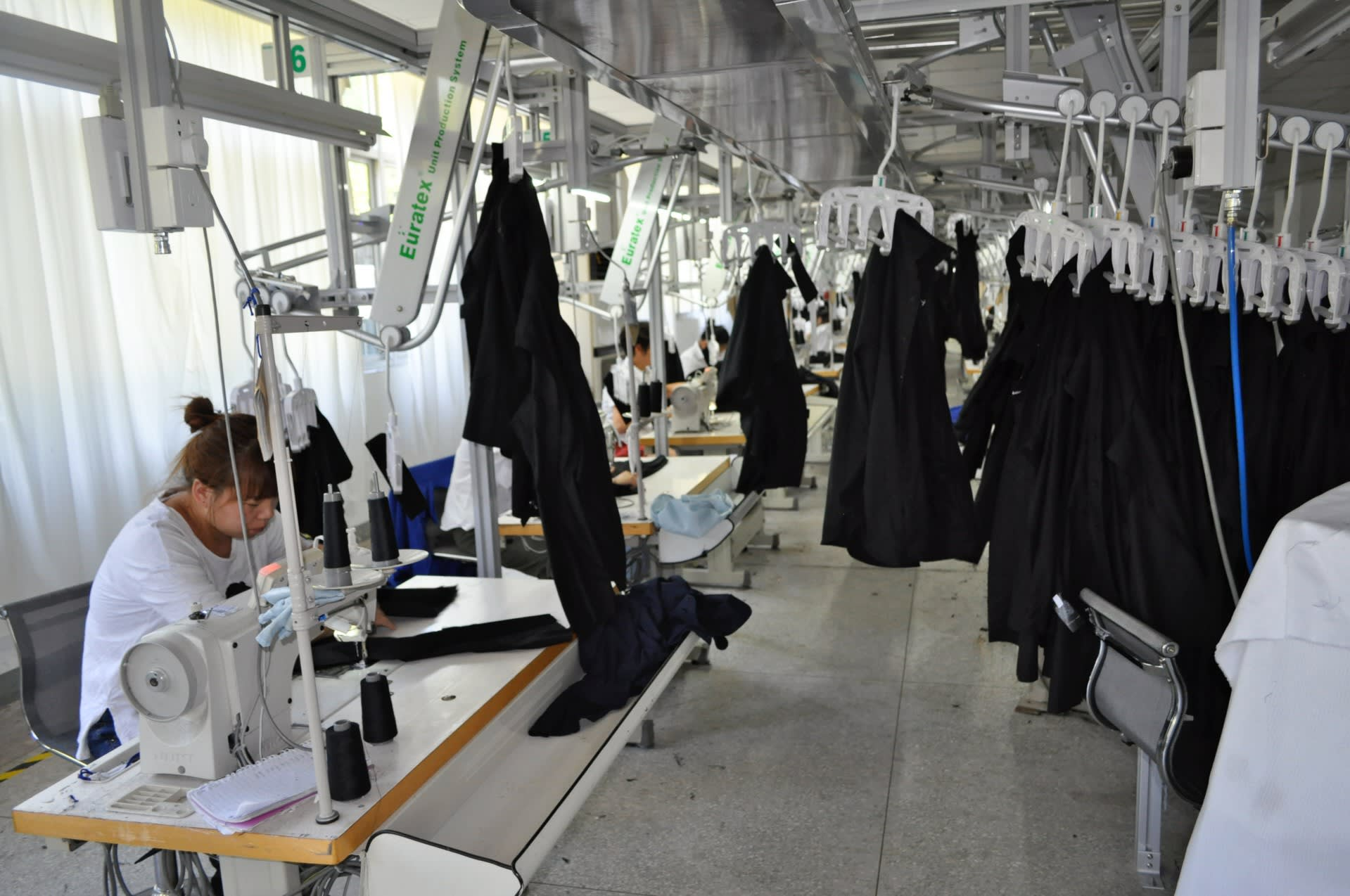 China's garment factories try to stay one stitch ahead