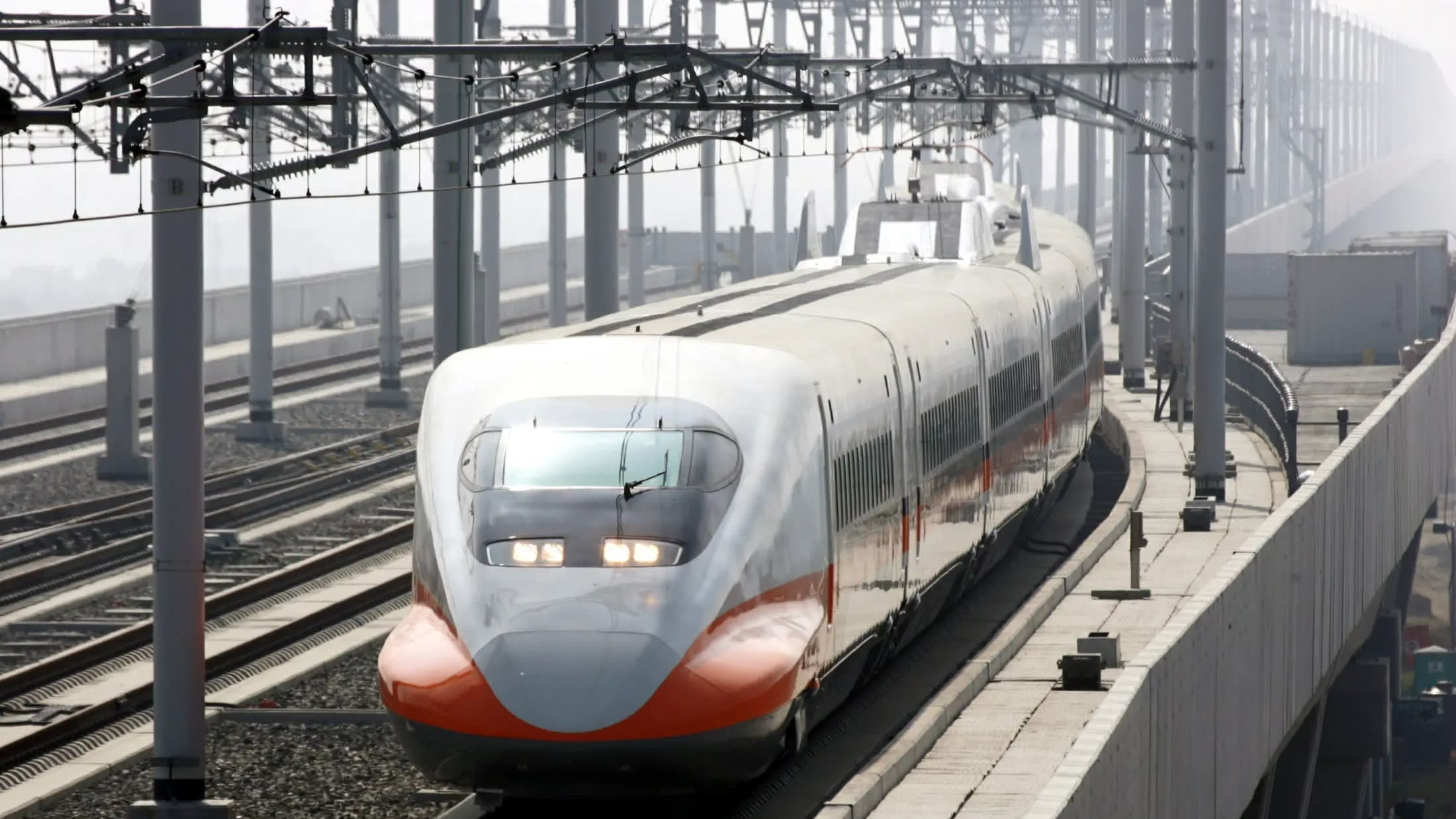 A train using Japan's shinkansen bullet train technology approaches a platform in Taiwan. Hitachi will supply train cars as Taiwan updates its aging rolling-stock fleet.