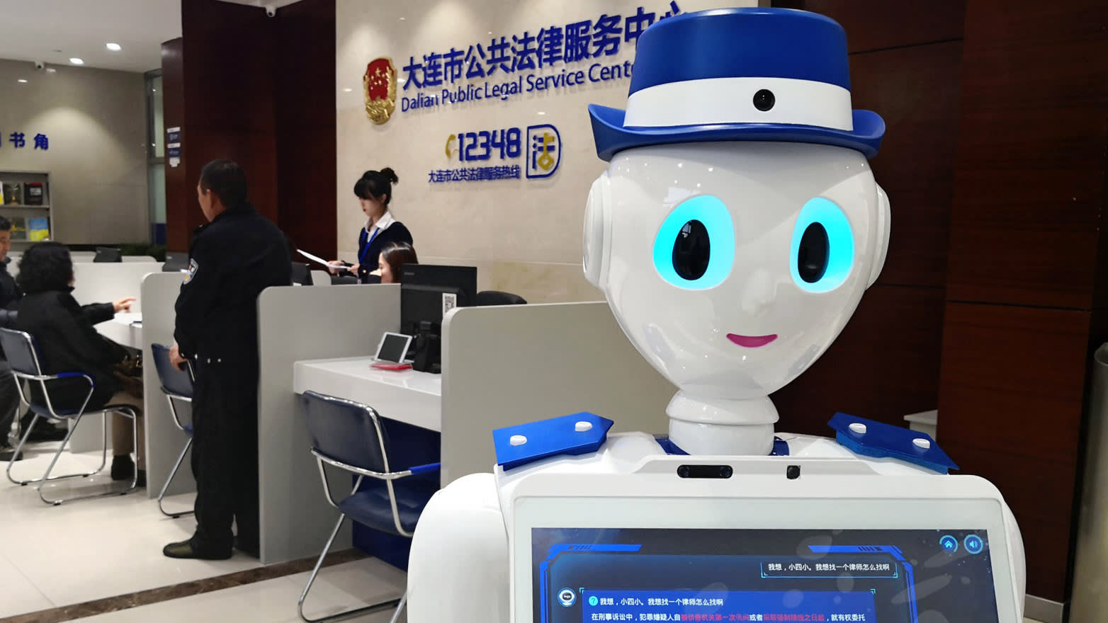 Service robots lend a hand at China's banks and railway