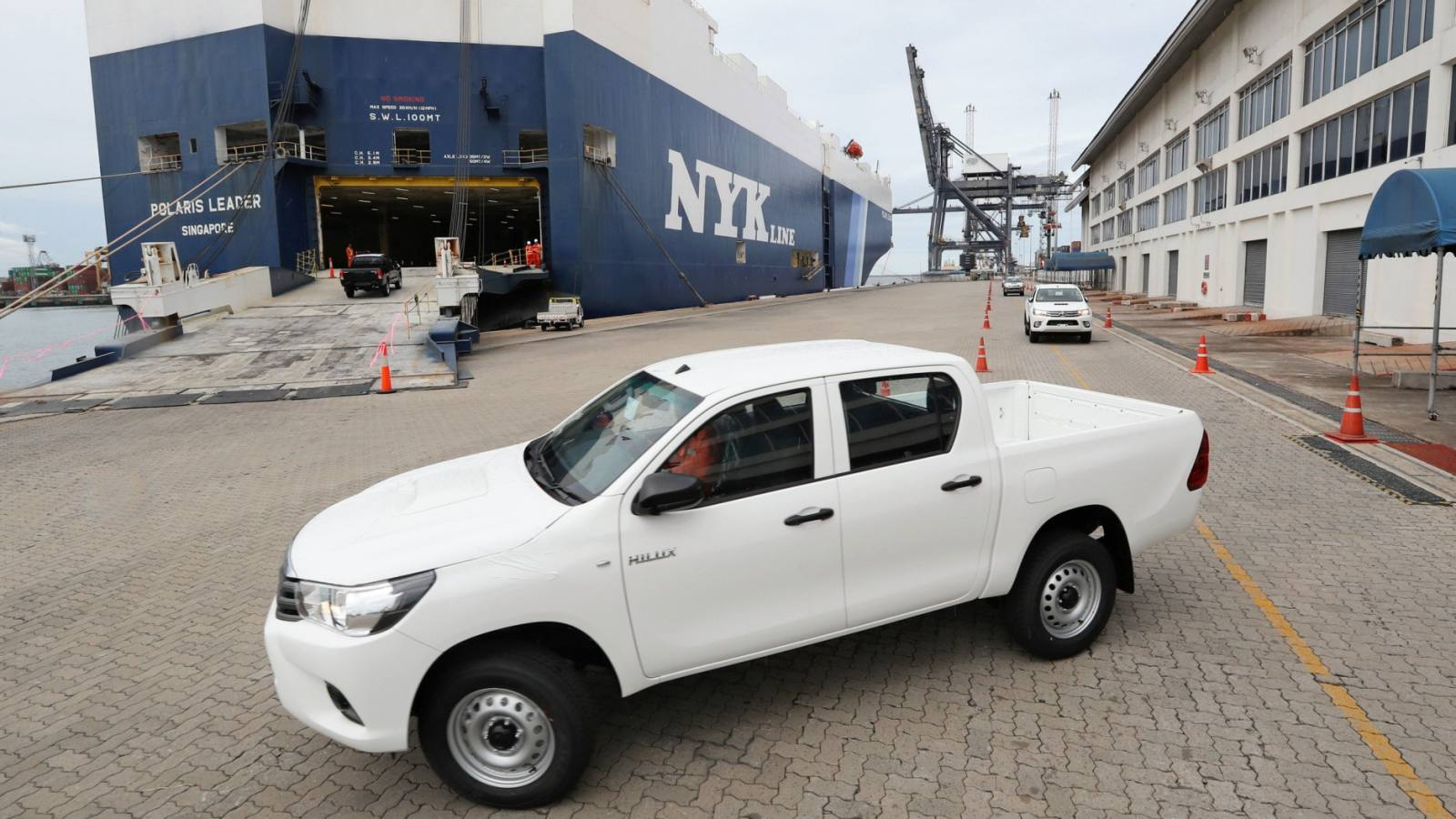 A locally manufactured Toyota pickup truck being driven onto a ship for shipment overseas at a Thai port. (Photo by Nozomu Ogawa)