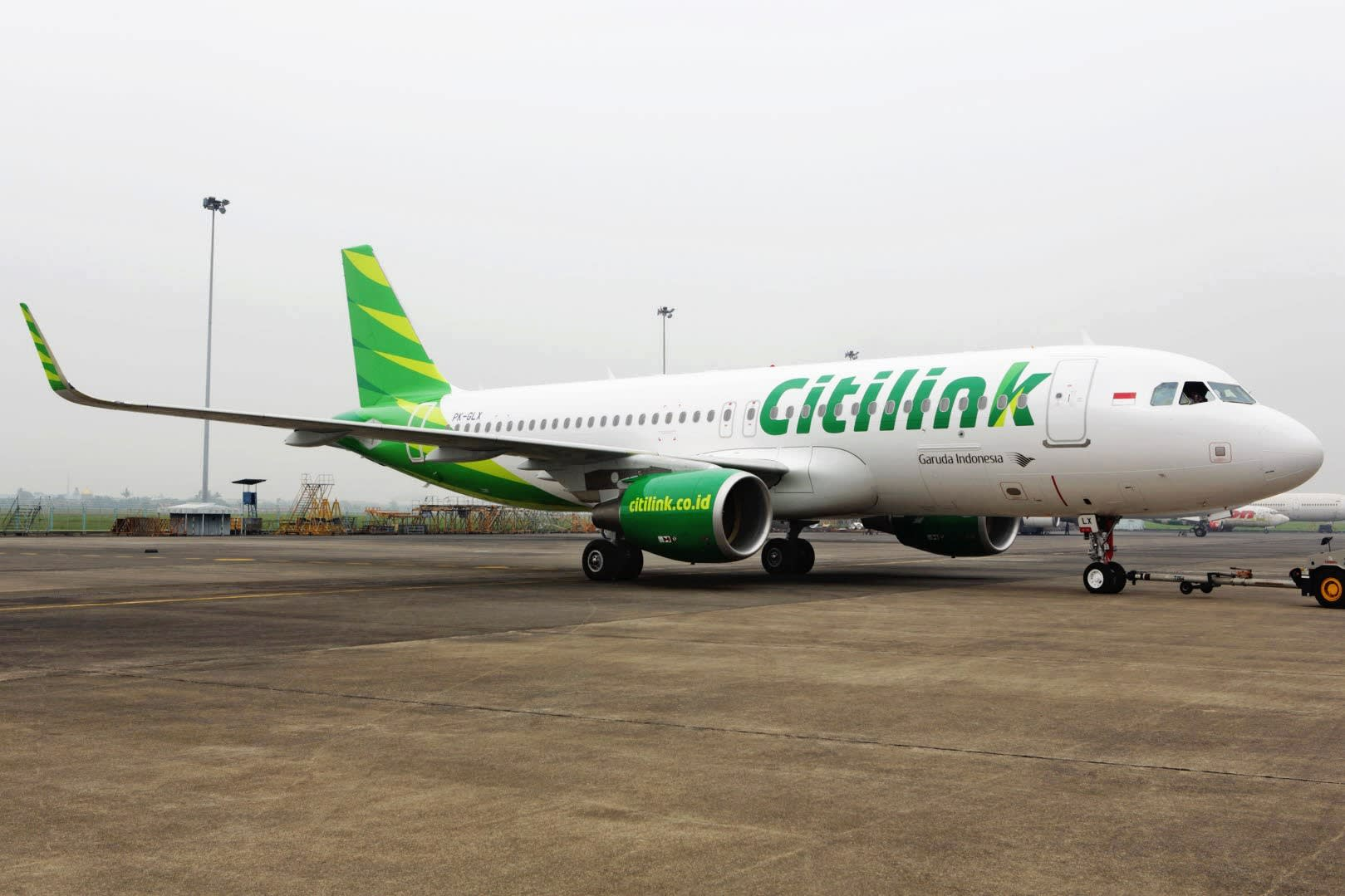Ceo of garudas budget unit to resign over drunk pilot nikkei a citilink airplane parked at an indonesian airport reheart Image collections