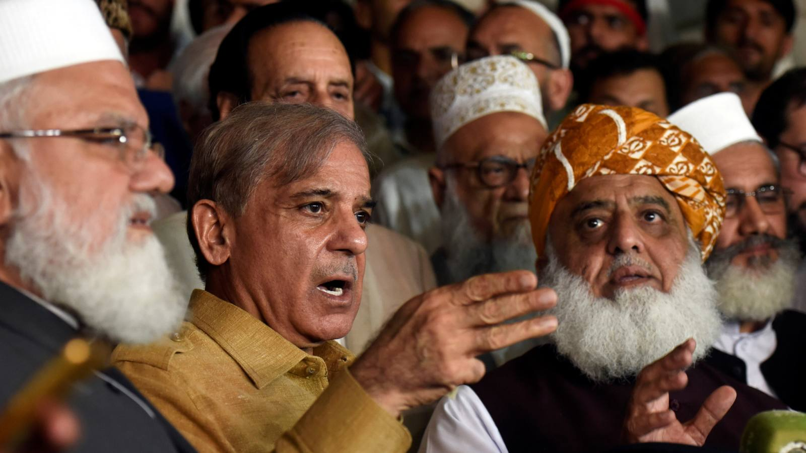 Shehbaz Sharif, second from left, the PML-N president and brother of Nawaz Sharif, speaks during a news conference as Fazal ur Rehm Jamiat Ulma-e-Islamparty leader looks on after an All Parties Conference in Islamabad onJuly 27.