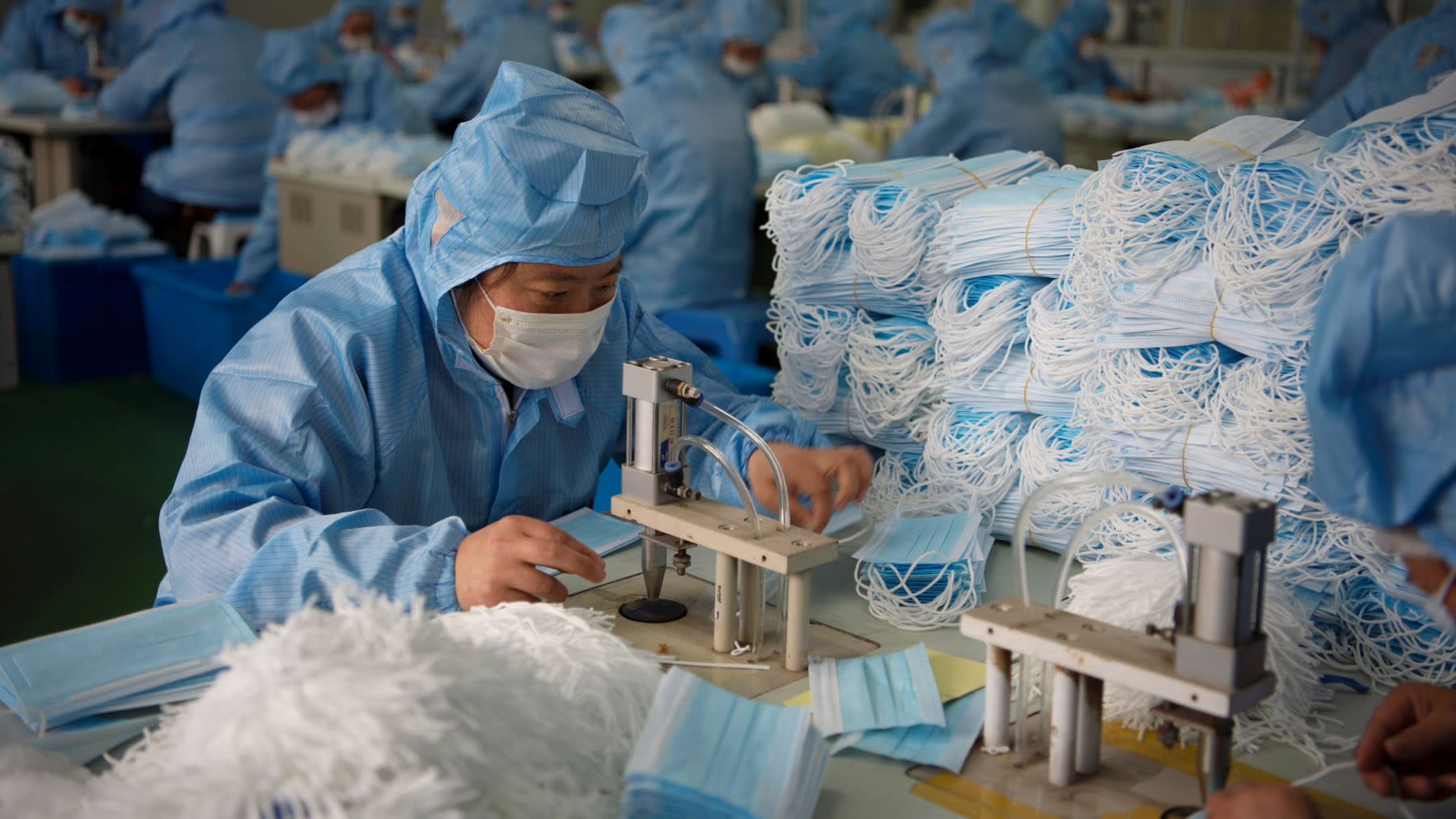 China pushes all-out production of face masks in virus fight ...