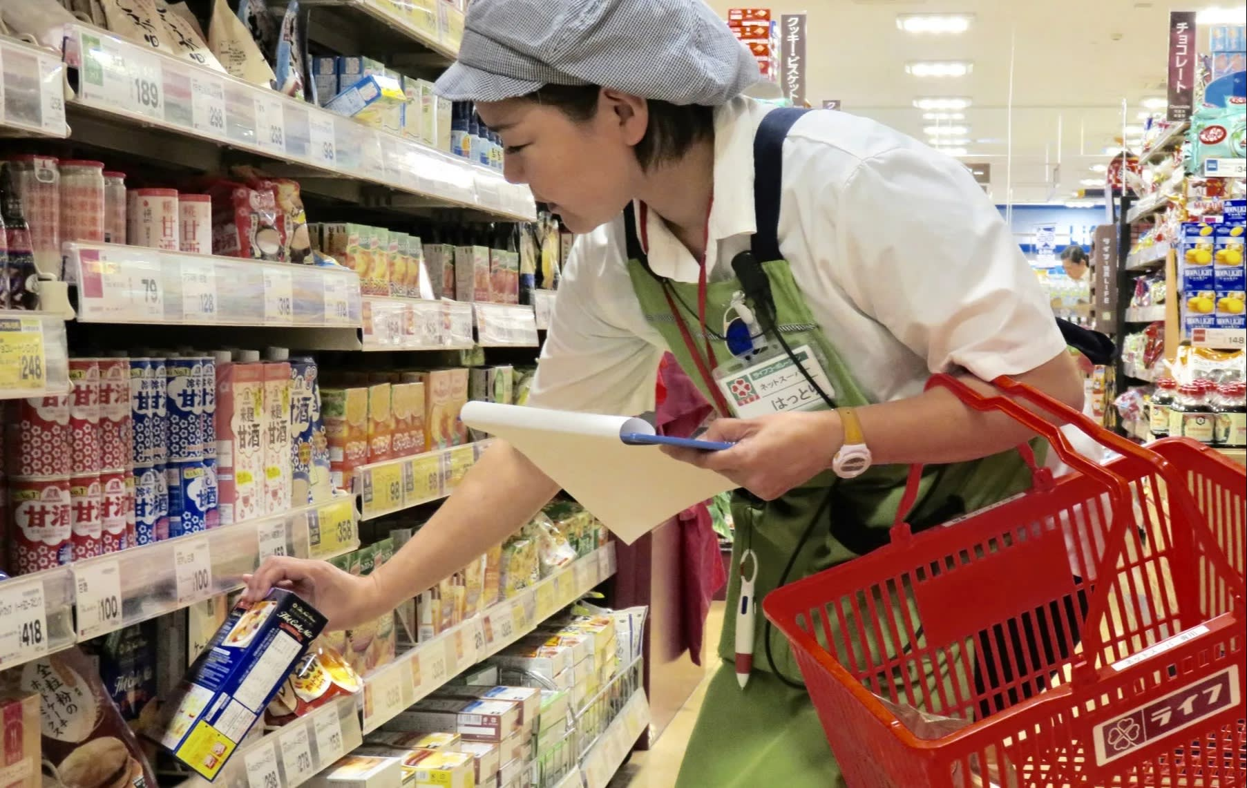 Under the partnership with Amazon Japan, workers at Life supermarkets will gather the items ordered by customers online for delivery. (Photo by Kento Hirashima)