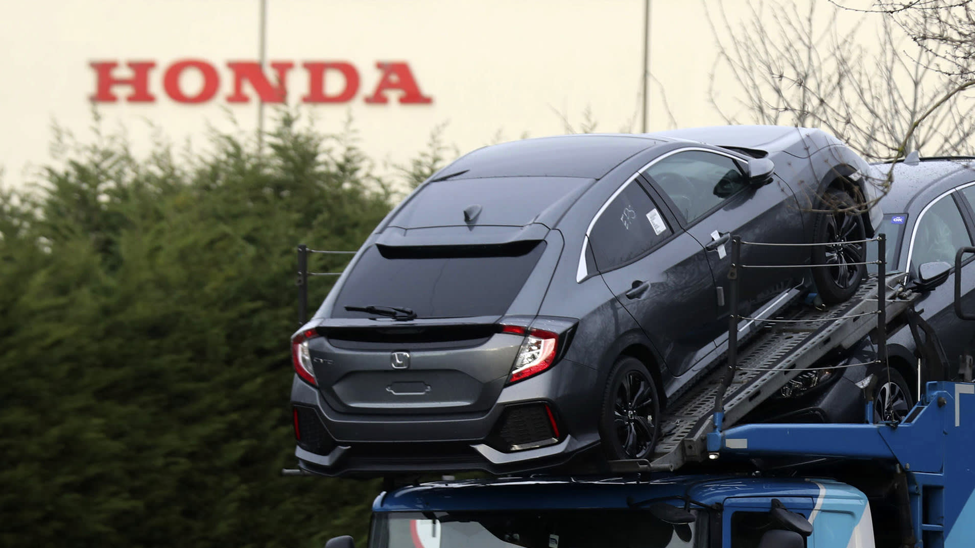 Honda Civic hatchbacks await export from the U.K. The Japanese automaker's sole European auto plant, in Swindon, has been operating below capacity amid faltering sales.