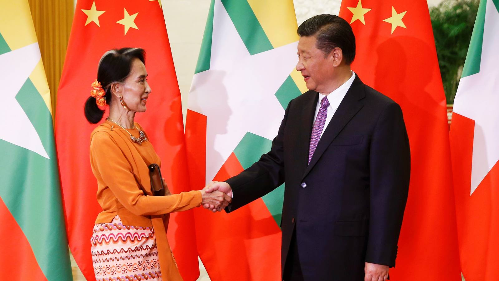Myanmar's de facto leader Aung San Suu Kyi, left, met with Chinese President Xi Jinping last year. Suu Kyi has visited China three times since assuming leadership.