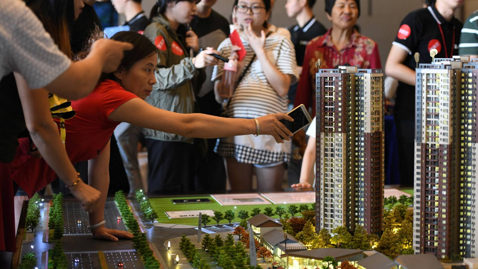A model residential compound in a China Vanke showroom. Growth in condominium sales prices slowed in July-September, dampening Vanke's and peers' expectations of demand.
