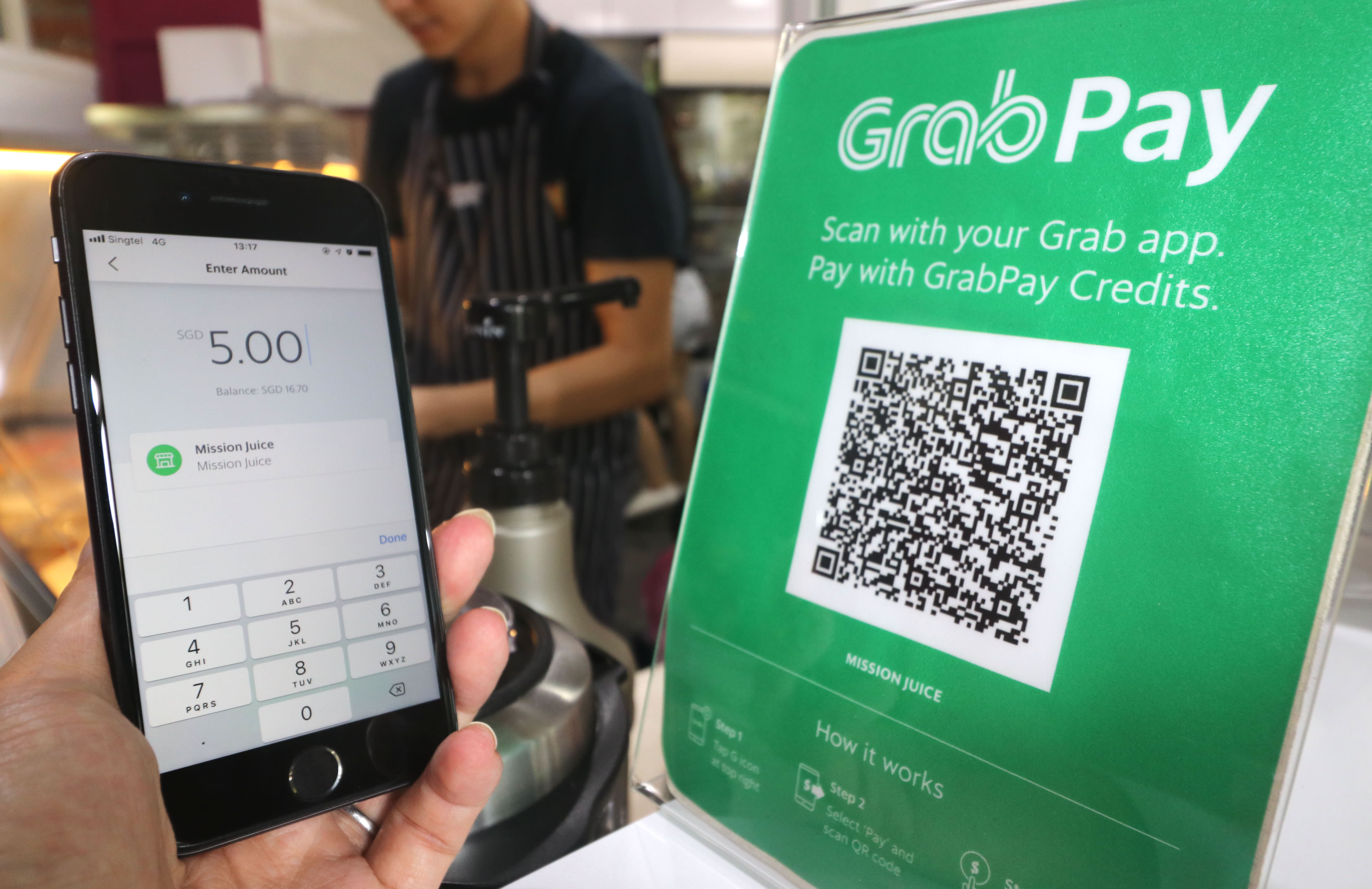 Grab pushes e-payments in SE Asia as Go-Jek expands - Nikkei Asian