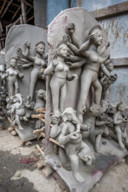 Assorted idols sit outside to dry on the streets of Kumartuli. (Photo by Kit Yeng Chan)
