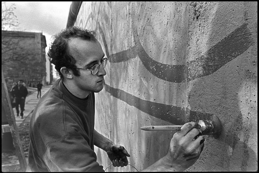 Keith Haring paints the Berlin Wall at Checkpoint Charlie, 23 October 1986 ©Stiebing\/UllsteinBild via Getty