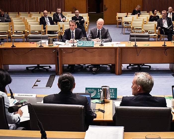 Matt Comyn (left), new chief executive of Commonwealth Bank of Australia, and his predecessor Ian Narev attend a hearing at Australia's parliament