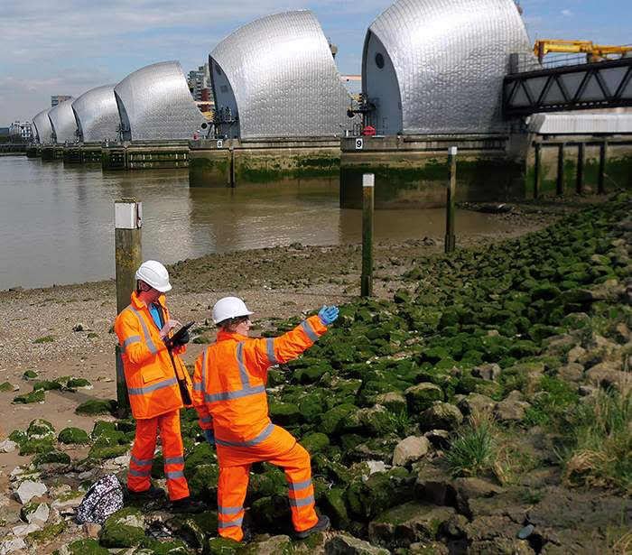 Some of the Thames Barrier team in front of the Barrier