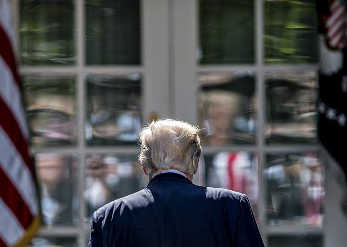 President Donald Trump walks away after announcing that the US would withdraw from the Paris accord