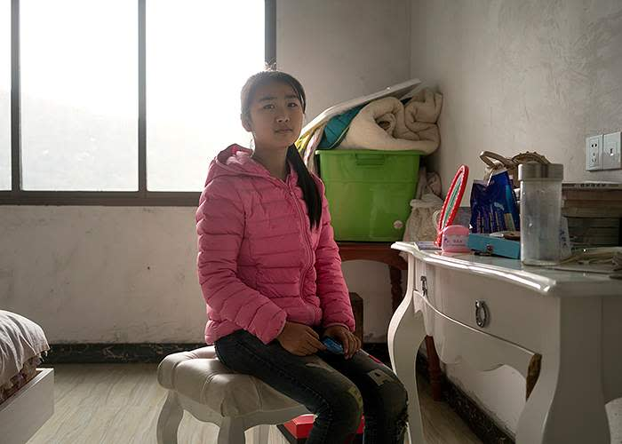 Eva in her family home in Pingshang township, Hunan province