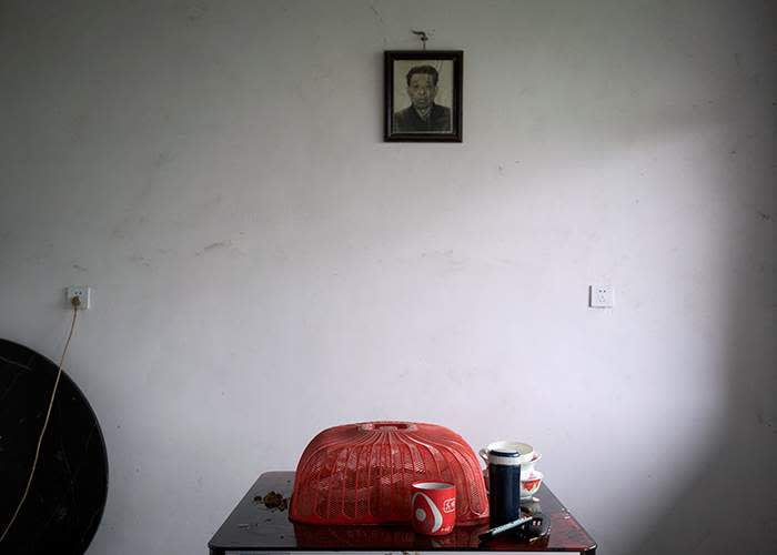A portrait of Eva's deceased grandfather at home in Pingshang
