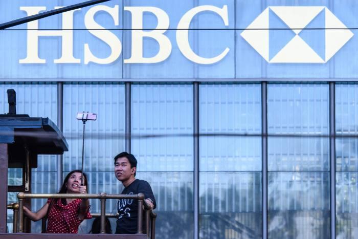 HSBC profits rise as costs fall - FTAdviser com