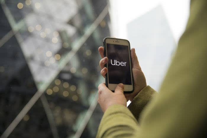 Uber to auto-enrol drivers after court ruling