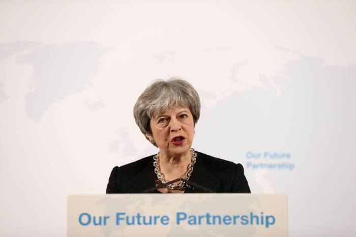 May rules out passporting for financial services post Brexit