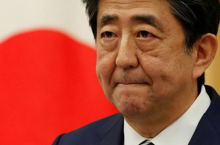 Japan stocks fall amid reports PM will resign