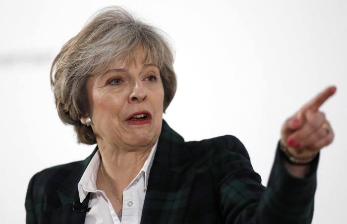 May pledges Treasury action on rogue advisers