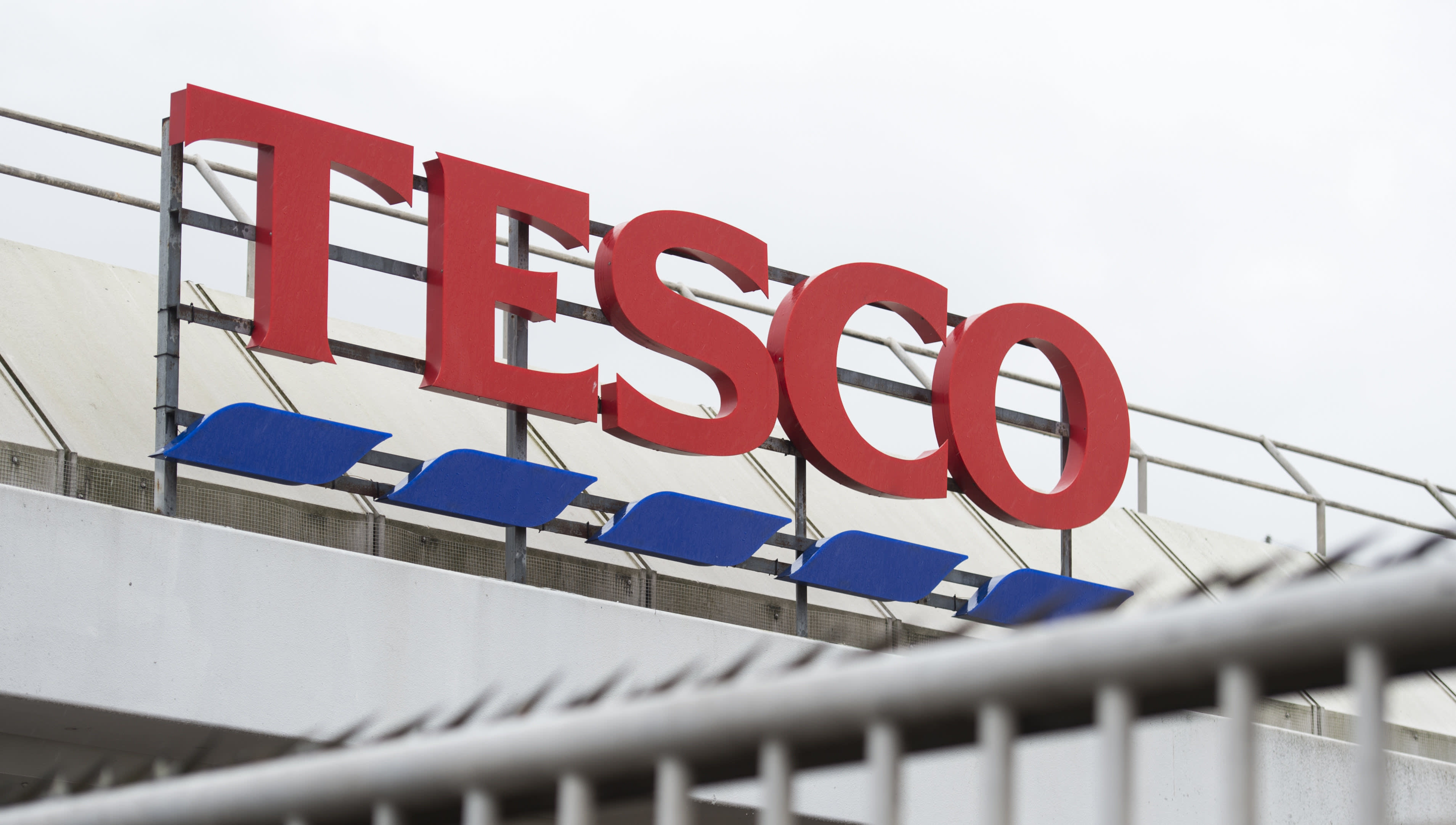 Tesco profits fall as bank absorbs FCA fine