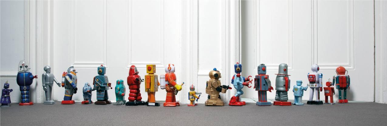 Row of tin toys in front of door