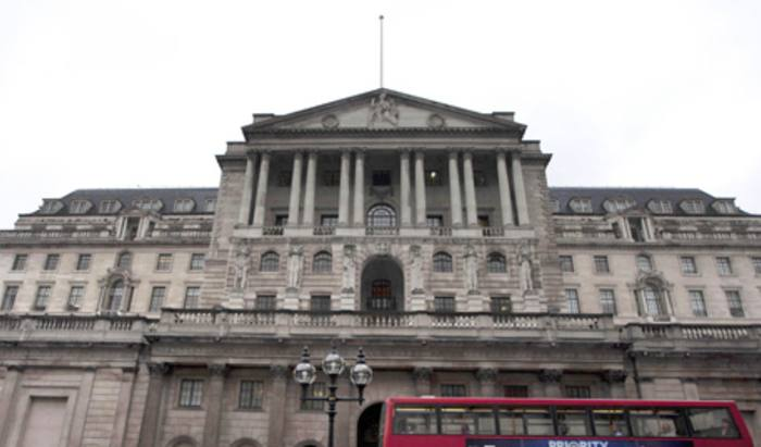 Pound drops as Bank of England signals rate cut