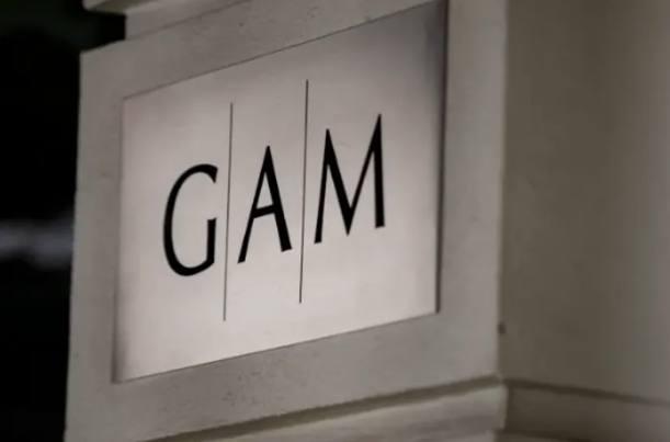 GAM warns on profits as it takes £350m hit