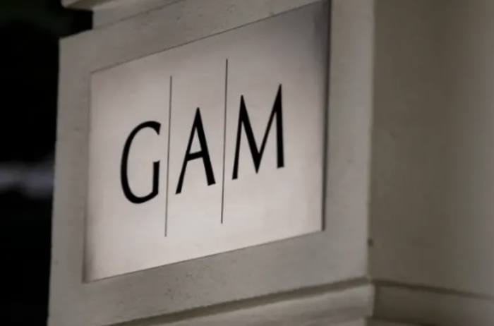 GAM warns on profits as it takes £350m hit