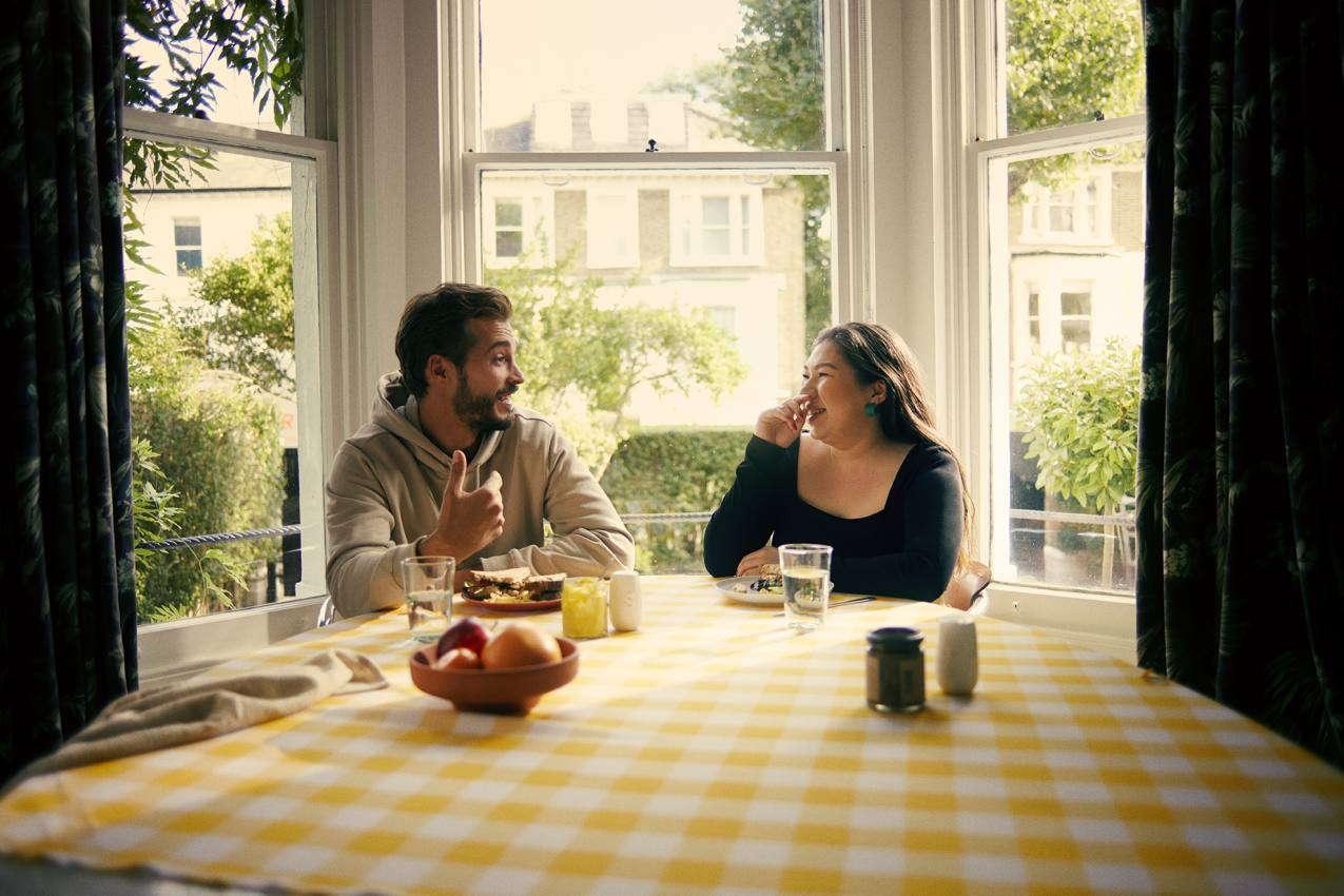 Two people chatting over the dining table