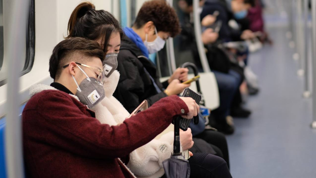 Commuters wearing SARS masks on train