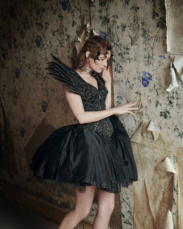 Moschino satin dress, £11,000. VV Rouleaux feathers (worn as hairpins), £24.95 a metre