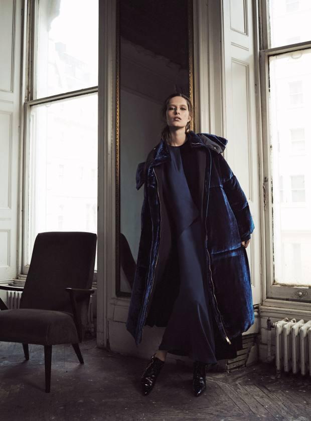Stella McCartney velvet Marcelline coat, £1,480, and silk/viscose and velvet Graziella dress, £1,260. Joseph leather boots, £515. Alighieri gold plated bronze earrings, £180. Liberty velvet chair, £3,995 for a pair