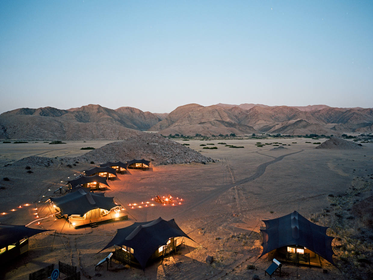 Hoanib Valley Camp in the Sesfontein reserve is set against the craggy hills of the Kaokoveld Desert