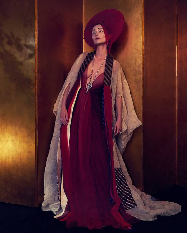 Schiaparelli Haute Couture silk organza and silk twill kimono, price on request. Luisa Beccaria silk tulle dress, £4,200. Harvy Santos silk and nylon W ataboshi hood, made to order. Van Cleef & Arpels white and rose gold, diamond, sapphire, chalcedony, onyx, cultured pearl and spinel Secret d'une Etoile earrings, white and rose gold, diamond, sapphire, ruby, cultured pearl, lapis lazuli and spinel Ryujin necklace, and white, yellow and rose gold, diamond, sapphire and ruby Secret des Abeilles ring, all price on request