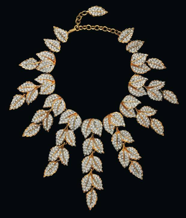 A rhinestone-and-gilt leaf fringe necklace by Kenneth Jay Lane, c1975, estimate $1,000-$1,500