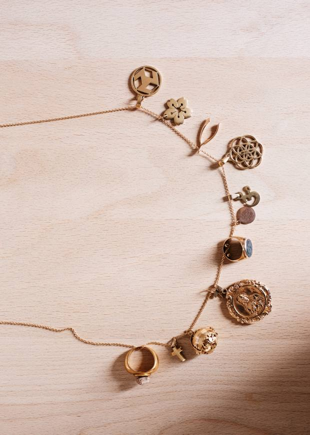 Hearst's collection of charms on a gold chain by Jar