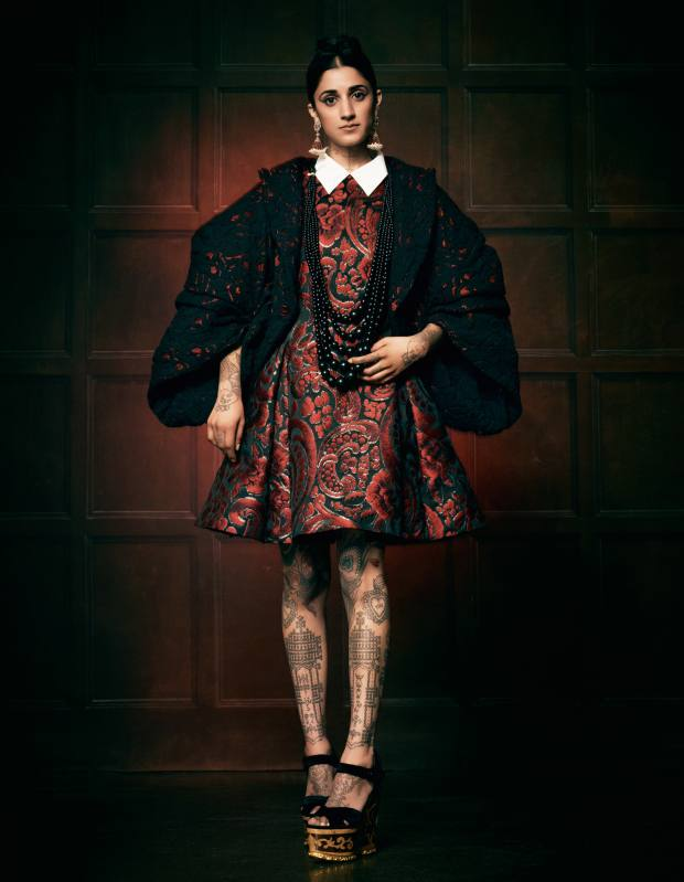 Polyester jacket, about £2,076, by Comme des Garçons. Brocade dress, £935, by Moschino. Velvet and inlaid-wood wedge sandals, about £916, by Dolce & Gabbana. 18ct gold and silver earrings with diamonds, rubies and pearls, £7,000, by Amrapali. Wooden-bead necklace, £345, by Monies at Talisman Gallery