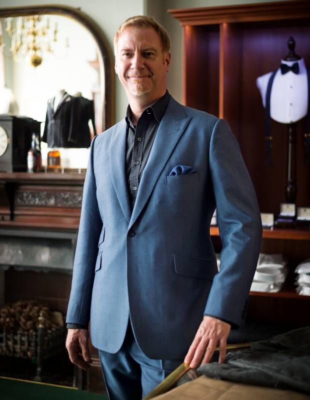 Marek Reichman at the Henry Poole showroom, wearing a Henry Poole wool/mohair one-button, single-breasted suit