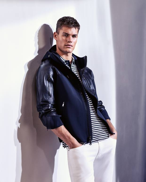 Ralph Lauren Purple Label neoprene and leather Morham jacket, £3,330, cotton jersey polo shirt, £270, and denim jeans, £330