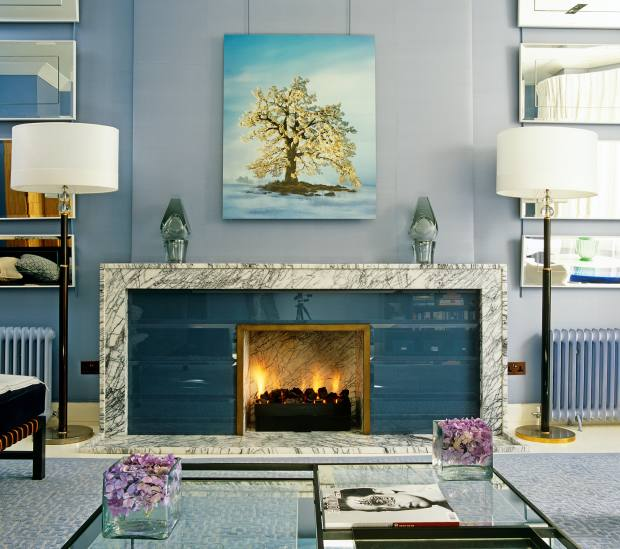 The silk-back glass of David Collins Studio's fireplace, from £30,000, is offset by a Turkish Lilac marble surround