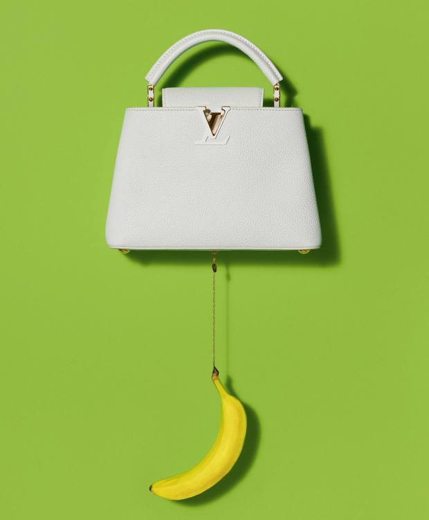 Urs Fischer's taurillon Capucines bag, €6,500, with a silicone banana charm dangling from a gold chain
