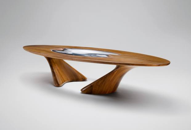 Zaha Hadid Architects American-walnut and acrylic UltraStellar dining table, from £198,000, from David Gill Gallery