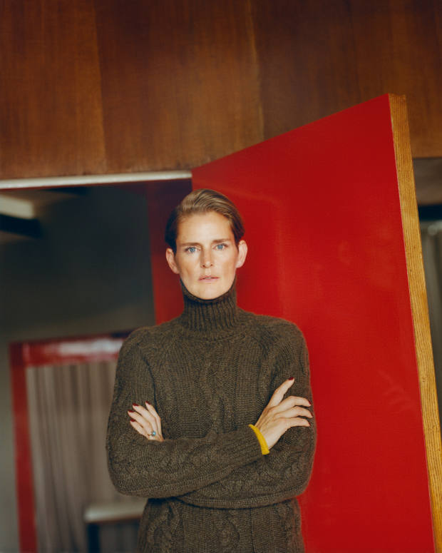 Stella Tennant wears Holland & Holland cashmere jumper, £750, and wool skirt, £590