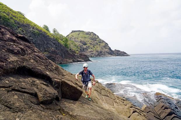 Scrambling up the rocky coastline, avoiding the rushing tide
